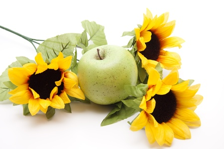 artificially:  Sunflower with green apple Stock Photo