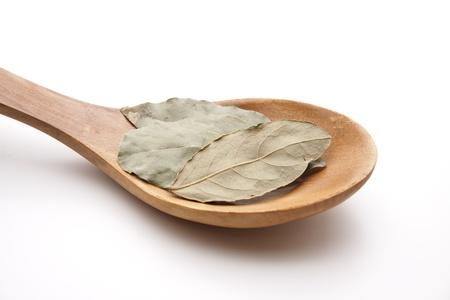 bay leaf: Bay leaf on a wooden spoon Stock Photo