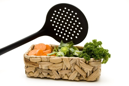 skimmer: Soup vegetables in the basket with skimmer Stock Photo