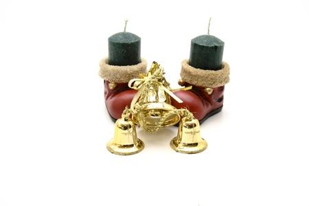 christmas perfume: Christmas boot with candle of perfume Stock Photo