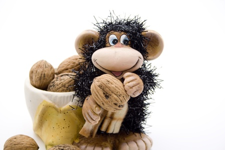 monkey nuts: Ceramic monkey with walnuts Stock Photo