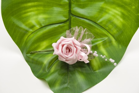 artificially: Rose with green leaf