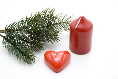 bougie coeur: Branche de sapin avec des bougies coeur