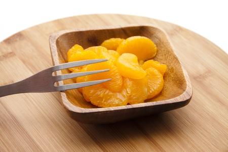 mandarins: Mandarins in wooden scarfs Stock Photo