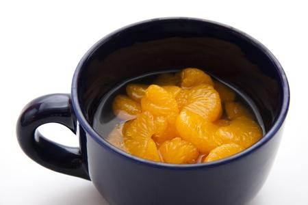 mandarins: Mandarins with cup