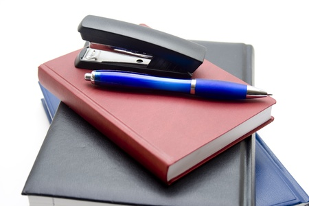 Notebook with ballpoint pen and stapler