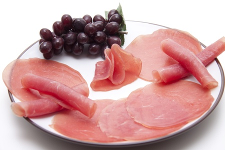 Salmon ham and grapes photo
