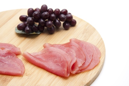 Salmon ham with wooden plate photo