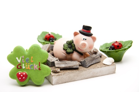 Luck pig with cloverleaf and candle Stock Photo - 13451812
