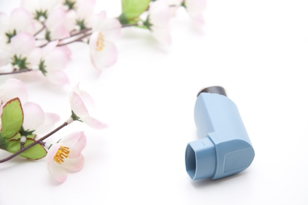 breathlessness: Asthma spray Stock Photo