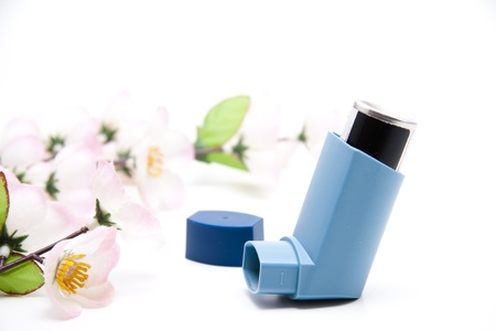 Asthma spray with flower branch