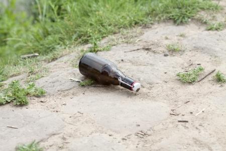 metal fastener: Empty beer bottle
