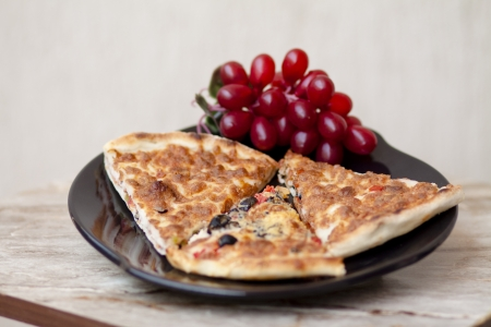 Fresh pizza with olives photo