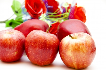Red apples with floral decoration