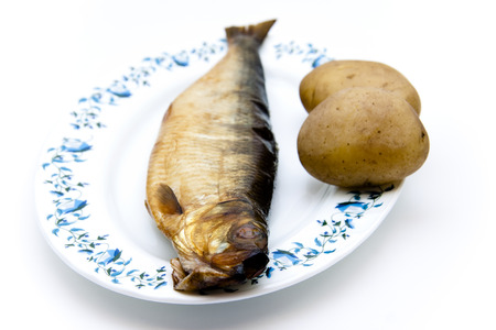 Herring smoked with potatoes on plate Stock Photo