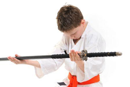 keeps: boy in kimono keeps on hand katana