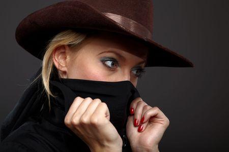 girl wearing black clothes, hat , face illuminated photo