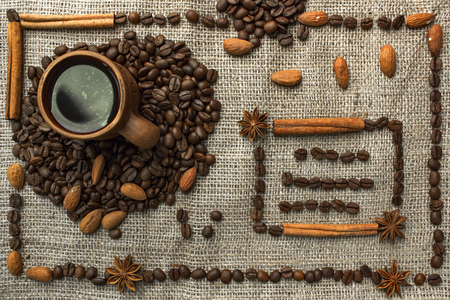 Frame made of coffee beans on traditional sack textile