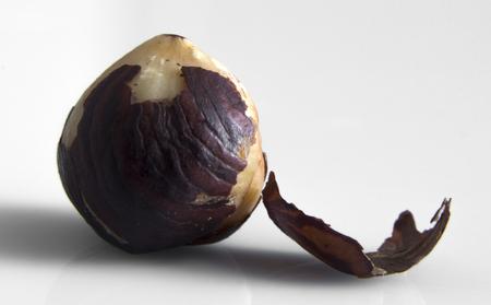 Hazelnut. Three peeled organic filbert isolated on white background Stock Photo