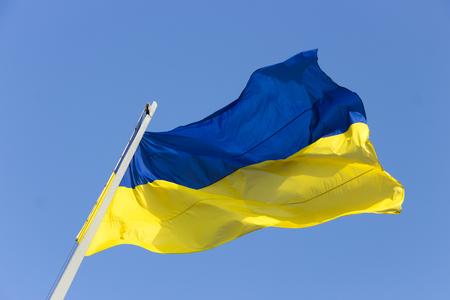 flagstaff: ukrainian national flag against the blue sky Stock Photo