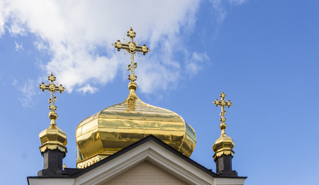 Gilding the dome of the Orthodox cathedral against the blue sky