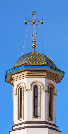 Gilding the dome of the Orthodox cathedral against the blue sky background
