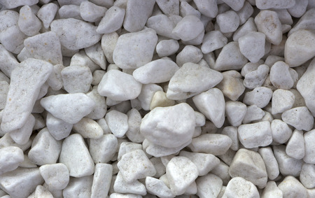 Polished colored marble pebbles and semi-precious stones background