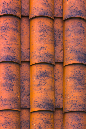 Red plastic roof tiles home