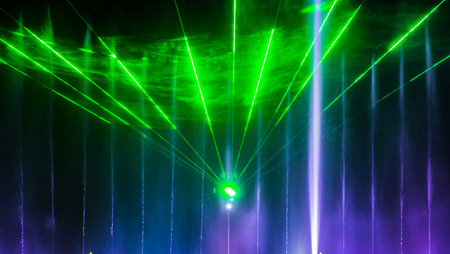 The city of Vinnytsia is a waterfront near the Roshen plant, in the evenings the fountain shows a laser show for residents and guests of the city. Stock Photo
