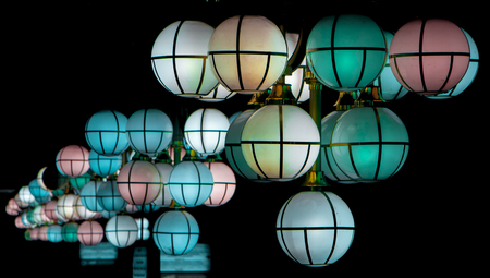 The street lamp in the form of bunches of different colors of round form.