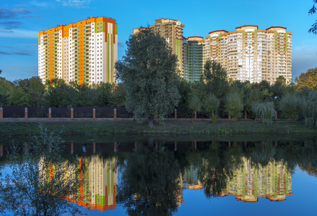 View of the multi-storey buildings on the shore of the lake. Stock Photo