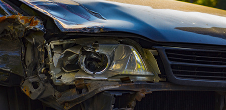 Broken car headlight, close up large plan, due to road traffic adventure