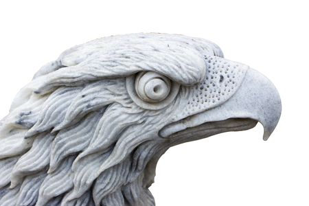 Eagle carved from white marble. Isolated on white close-up 스톡 콘텐츠