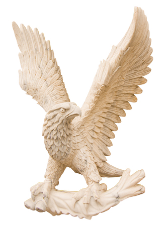 Eagle carved from white marble. Isolated on white close-up Фото со стока