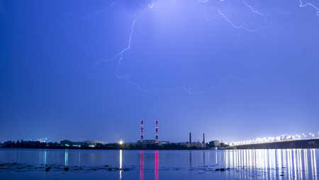 Lightning in the night sky above the city.