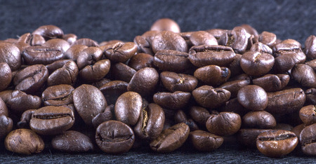 texture of coffee, with beautiful patches of light on the surface of grains texture