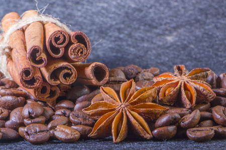 Close-up, roasted coffee seeds, tubberry, cinnamon sticks and chocolate