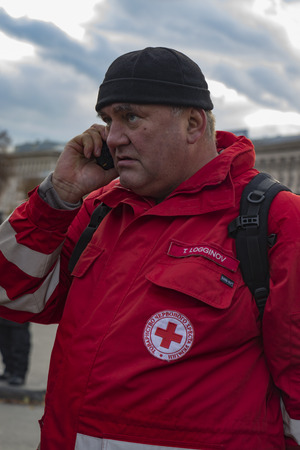 Kyiv, Ukraine, Independence Square, September 9: The Volunteer of the Red Cross stands near the building of the National Guard fighters