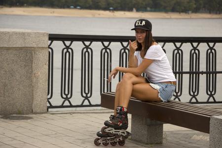 Ukraine Kiev Dnipro embankment August 20, 2017. Young attractive girl rolls on skates