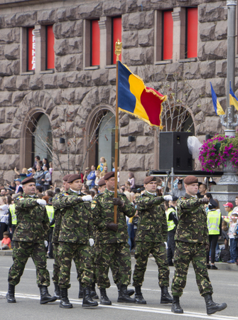 KYIV, UKRAINE - MAY 24, 2017: Military parade in Kyiv dedicated to the Independence Day of Ukraine, 26th anniversary. Soldiers in the colony step on Khreshchatyk.
