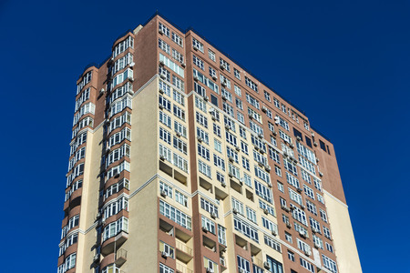 The facade of a typical block multi-storey residential building. Front view close up Stock Photo