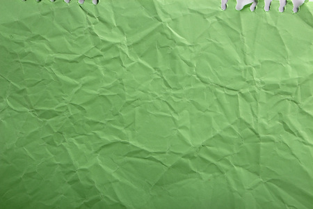 Green crepe Wrinkled Paper Texture background abstract.