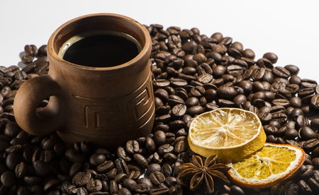 clay cup with coffee on the background of grains background Stock Photo