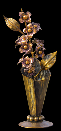 Forged bouquet of flowers in a metallic vase, golden in color, isolated on a homogeneous background
