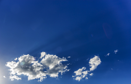 White cloud on a clear blue sky