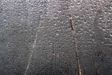 Blue water drops on window glas background Stockfoto