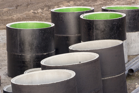 Concrete rings and pipes covering bitumen for sewerage