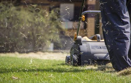 Gardener Operating Soil Aeration Machine on Grass Lawn Stok Fotoğraf