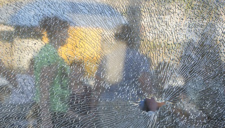 broken tempered glass closeup , background of glass was smashed