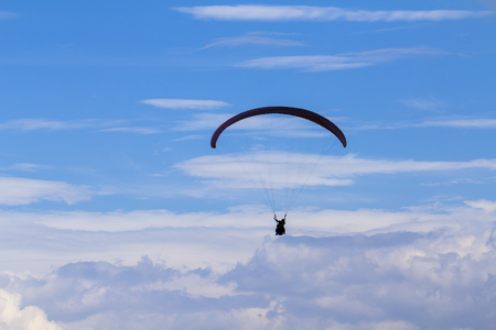 Active lifestyle, extreme hobbies. Skydiver flight against the blue sky. Stock Photo